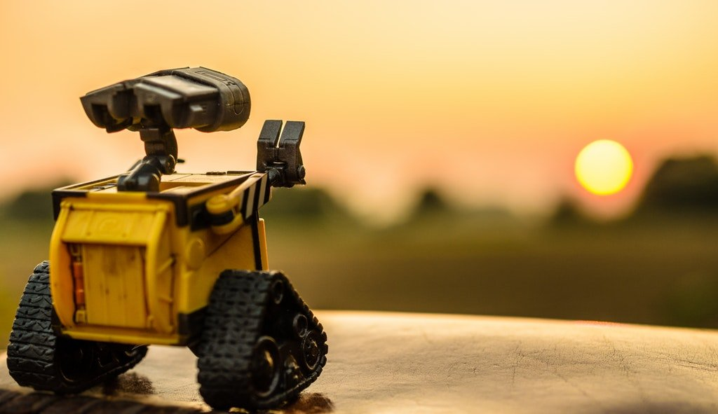 A prototype robot looking at a Los Angeles sunset